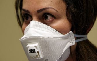 OAKLAND, CA - APRIL 28:  A nurse at the La Clinica San Antonio Neighborhood Health Center wears a N95 respiratory mask during a training session April 28, 2009 in Oakland, California. As the number of swine flu cases in the U.S. continues to rise, doctors and nurses at La Clinica's 26 facilities are being trained to use the N95 respiratory mask to be worn if they come in contact with a patient wo is suspected of having the swine flu or tuberculosis.  (Photo by Justin Sullivan/Getty Images)
