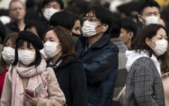 TOKYO, JAPAN - FEBRUARY 02: People wearing masks wait to cross a road  in the Shibuya district on February 02, 2020 in Tokyo, Japan. Japan reported 20 cases of Wuhan coronavirus infections as the number of those who have died from the virus, known as 2019-nCoV, in China climbed to over 300 and cases have been reported in other countries including the United States, Canada, Australia, Japan, South Korea, India, the United Kingdom, Germany, France, and several others.  (Photo by Tomohiro Ohsumi/Getty Images)
