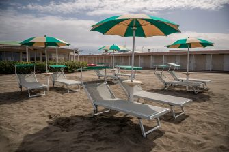 """ROME, ITALY - MAY 10: Sun loungers are installed to test the social distance at Summer resort facility """"La Bonaccia"""" at Ostia beach closed during 'phase two' of measures to tackle the Coronavirus (Covid-19) pandemic, on May 10, 2020 in Rome, Italy. Italy was the first country to impose a nationwide lockdown to stem the transmission of the Coronavirus (Covid-19), and its restaurants, theaters and many other businesses remain closed. (Photo by Antonio Masiello/Getty Images)"""