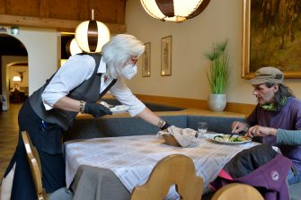 BOLZANO, ITALY - MAY 11: A waitress wearing a face mask at work in the restaurant after today's business reopening on May 11, 2020 in Bolzano, Italy. The Bolzano province started the reopening of some businesses one week earlier than the rest of Italy, arising many controversies. (Photo by Alessio Coser/Getty Images)