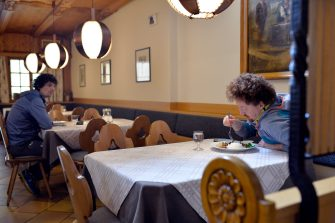 BOLZANO, ITALY - MAY 11: Two men at a restaurant table on May 11, 2020 in Bolzano, Italy. The Bolzano province started the reopening of some businesses one week earlier than the rest of Italy, arising many controversies. (Photo by Alessio Coser/Getty Images)