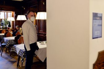 BOLZANO, ITALY - MAY 11: A waiter wearing a face mask at work in the restaurant after today's business reopening on May 11, 2020 in Bolzano, Italy. The Bolzano province started the reopening of some businesses one week earlier than the rest of Italy, arising many controversies. (Photo by Alessio Coser/Getty Images)