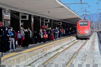 The arrival at the central railway station of the Frecciarossa high-speed train coming from Milan on the first day of Phase 2 during the Covid-19 emergency, in Naples, southern Italy, 04 May 2020. The passengers got off neatly and followed the path indicated by the police, lining up to have their body temperature checked. On the platform of the station, an employee with a megaphone reminds people getting off the train to keep the social distance. ANSA / CIRO FUSCO
