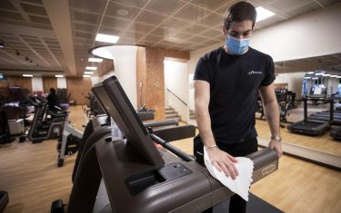 An attendant cleans the gym machines  inside at Heaven Fitness Gym in Rome, Italy, 25 May 2020. The reopening of the 8,114 gyms and fitness centers is expected by 18 million Italians who play sports.