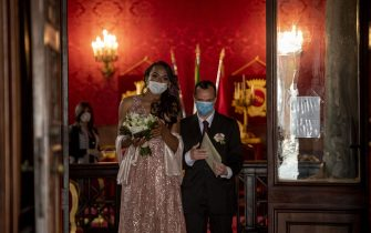 ROME, ITALY - APRIL 24: Sergio and Sophia wearing the protective masks attend their wedding ceremony at Campidoglio during the Coronavirus (COVID-19) pandemic, on April 24, 2020 in Rome, Italy. Italy is still remaining on lockdown until May 4th to stem the transmission of the Coronavirus (Covid-19). (Photo by Antonio Masiello/Getty Images)