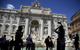 Few tourists visit the Trevi Fountain in Rome's city centre, Rome, Italy, 6 August 2020. The Italian tourism industry is experiencing an unprecedented crisis, as evidenced by the figure for the employed, which fell to 20% of the sector's normal workforce. ANSA/RICCARDO ANTIMIANI