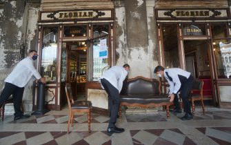 Three waiters work outside the historic  Caffè Florian in San Marco square in Venice, Italy, 12 June 2020. ANSA / ANDREA MEROLA