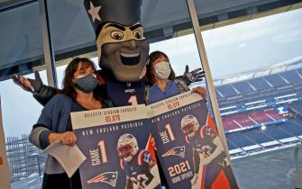 Foxborough, MA. - February 16: 80 year old Brigitte Peters of Uxbridge is the 65,878 vaccination at Gillette Stadium on February 16, 2021 in Foxborough, Massachusetts. 65,878 is seating capacity of Gillette Stadium and was given two tickets to the season opener from Pat Patriot. Posing with her daughter Nancy Ballou of Douglas.  (Staff Photo By Matt Stone/MediaNews Group/Boston Herald)