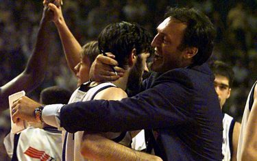 PIR14-19980803-PIRAEUS, GREECE: Dino Meneghin (R), former Italian basketball star, embraces his son Andrea (C) after Italy defeated Yugoslavia 61-60 in their match for the World Basketball Championship in Piraeus, near Athens 03 August.  (ELECTRONIC IMAGE-BEST QUALITY AVAILABLE)   EPA PHOTO  Srdjan SUKI