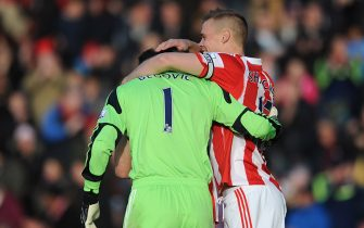 STOKE ON TRENT, ENGLAND - NOVEMBER 02: Asmir Begovic (L) of Stoke City is congratulated by team-mate Ryan Shawcross after scoring the opening goal during the Barclays Premier League match between Stoke City and Southampton on November 02, 2013 in Stoke on Trent, England. (Photo by Chris Brunskill/Getty Images)