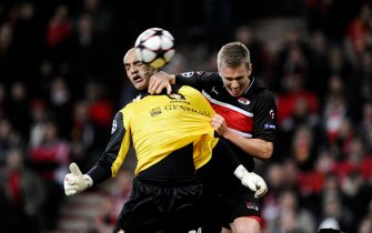 Standard Liege's goalkeeperkeeper Sinan Bola (L) heads the ball against AZ Alkmaar during their UEFA Champions League group H football match at the Maurice Dufrasne stadium in Liege on December 9, 2009. AFP PHOTO/ JOHN THYS (Photo credit should read JOHN THYS/AFP/Getty Images)