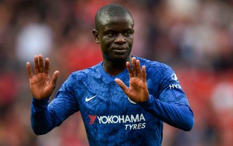 Chelsea's French midfielder N'Golo Kante reacts on the pitch at the final whistle in the English Premier League football match between Manchester United and Chelsea at Old Trafford in Manchester, north west England, on August 11, 2019. - Manchester United won the game 4-0. (Photo by Oli SCARFF / AFP) / RESTRICTED TO EDITORIAL USE. No use with unauthorized audio, video, data, fixture lists, club/league logos or 'live' services. Online in-match use limited to 120 images. An additional 40 images may be used in extra time. No video emulation. Social media in-match use limited to 120 images. An additional 40 images may be used in extra time. No use in betting publications, games or single club/league/player publications. /         (Photo credit should read OLI SCARFF/AFP/Getty Images)