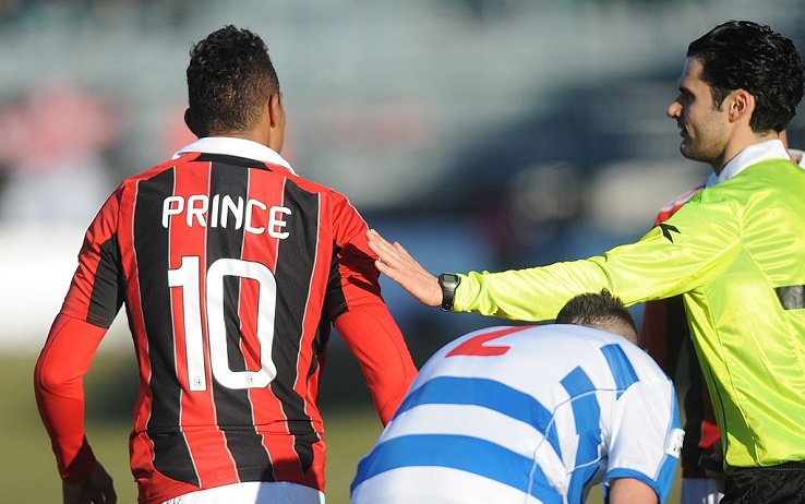 """Ac Milan's Ghanaian defender Prince Kevin Boateng leaves the pitch during the friendly football match between Pro Patria and Ac Milan in Busto Arsizio on January 3, 2013. Boateng stormed off the pitch after racist chants from a group of fans on Thursday, forcing a friendly away game against fourth-tier club Pro Patria to be suspended. """"Shame that these things still happen,"""" the 25-year-old German-born Ghanaian player said on his Twitter account after the match was stopped in the 26th minute when he led his team off the pitch. Boateng picked up the ball, kicked it towards the stands and walked off the pitch in Pro Patria's home town of Busto Arsizio near Milan. AFP PHOTO / ALBERTO LINGRIA        (Photo credit should read ALBERTO LINGRIA/AFP via Getty Images)"""