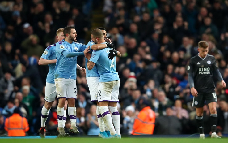 MANCHESTER, ENGLAND - DECEMBER 21: Riyad Mahrez of Manchester City celebrates with teammates after scoring his team's first goal during the Premier League match between Manchester City and Leicester City at Etihad Stadium on December 21, 2019 in Manchester, United Kingdom. (Photo by Clive Brunskill/Getty Images)