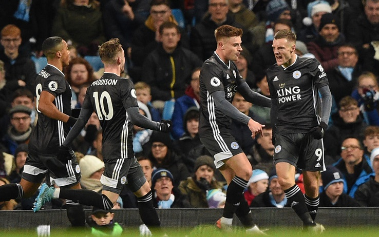Leicester City's English striker Jamie Vardy (R) celebrates with teammates after scoring the opening goal of the English Premier League football match between Manchester City and Leicester City at the Etihad Stadium in Manchester, north west England, on December 21, 2019. (Photo by Oli SCARFF / AFP) / RESTRICTED TO EDITORIAL USE. No use with unauthorized audio, video, data, fixture lists, club/league logos or 'live' services. Online in-match use limited to 120 images. An additional 40 images may be used in extra time. No video emulation. Social media in-match use limited to 120 images. An additional 40 images may be used in extra time. No use in betting publications, games or single club/league/player publications. /  (Photo by OLI SCARFF/AFP via Getty Images)