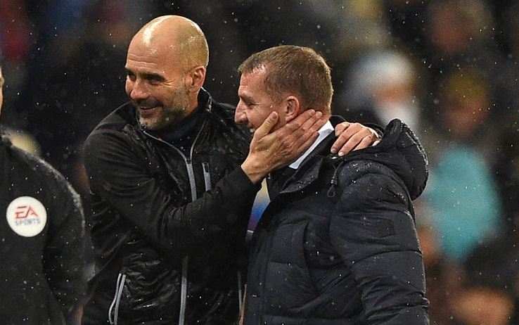 Manchester City's Spanish manager Pep Guardiola (L) embraces Leicester City's Northern Irish manager Brendan Rodgers after the English Premier League football match between Manchester City and Leicester City at the Etihad Stadium in Manchester, north west England, on December 21, 2019. - Manchester City won the game 3-1. (Photo by Oli SCARFF / AFP) / RESTRICTED TO EDITORIAL USE. No use with unauthorized audio, video, data, fixture lists, club/league logos or 'live' services. Online in-match use limited to 120 images. An additional 40 images may be used in extra time. No video emulation. Social media in-match use limited to 120 images. An additional 40 images may be used in extra time. No use in betting publications, games or single club/league/player publications. /  (Photo by OLI SCARFF/AFP via Getty Images)