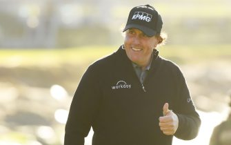 PEBBLE BEACH, CALIFORNIA - FEBRUARY 11:  Phil Mickelson of the United States walks up the 18th hole during the continuation of the final round of the AT&T Pebble Beach Pro-Am at Pebble Beach Golf Links on February 11, 2019 in Pebble Beach, California. (Photo by Harry How/Getty Images)