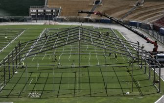 General view of the construction site of a temporary field hospital to house coronavirus patients for their isolation and recovery at Pacaembu stadium, in Sao Paulo, Brazil on March 23, 2020. - Brazil's top football clubs are handing over their stadiums to allow health authorities to turn them into field hospitals and clinics to fight the coronavirus pandemic. (Photo by NELSON ALMEIDA / AFP) (Photo by NELSON ALMEIDA/AFP via Getty Images)