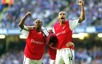 CARDIFF,WALES -MAY 4:  Freddie Ljungberg celebrates scoring Arsenal's 2nd goal with Thierry Henry and Sylvain Wiltord during the FA Cup Final match between Arsenal and Chelsea on May 4, 2002 in Cardiff, Wales. (Photo by Stuart MacFarlane/Arsenal FC via Getty Images)