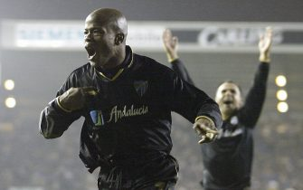 LEEDS - DECEMBER 12:  Dely Valdes of Malaga celebrates scoring their second goal during the UEFA Cup, third round second leg, match between Leeds United and Malaga at Elland Road on December 12, 2002 in Leeds, England. (Photo by Clive Mason/Getty Images).