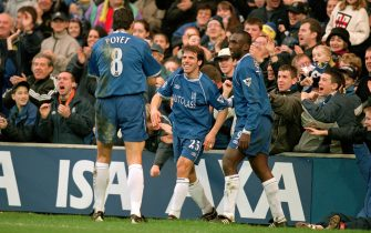 6 Jan 2001:  Gustavo Poyet, Gianfranco Zola and Jimmy Floyd Hasselbaink of Chelsea celebrate during the AXA sponsored FA Cup Third Round match against Peterborough played at Stamford Bridge in London. Chelsea won the game 5-0. \ Picture by Steve Bardens.\ Mandatory Credit: Allsport UK /Allsport