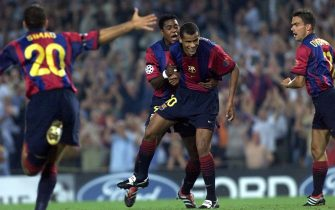 BARCELONA, SPAIN:  Barca's Brazilian Rivaldo (C) is congratulated by team-mates Kluivert (back) and Overmars (R) after he scored the first goal during their first round, first leg match Barcelona vs Leeds at Nou Camp stadium 13 September 2000 in Barcelona. AFP PHOTO CHRISTOPHE SIMON (Photo credit should read CHRISTOPHE SIMON/AFP via Getty Images)