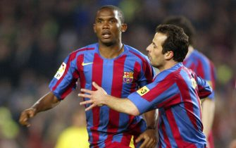 BARCELONA, SPAIN - APRIL 14: Samuel Eto'o and Ludovic Giuly of Barcelona cellebrate Eto'o's goal during the match between FC Barcelona and Villarreal, of La Liga, played at the Camp Nou stadium on April 14, 2006, in Barcelona, Spain. (Photo by Luis Bagu/Getty Images)