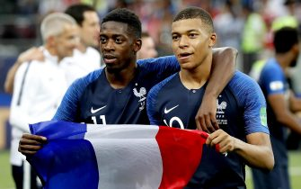 epa06891655 Kylian Mbappe of France (R) and Ousmane Dembele of France celebrate after the FIFA World Cup 2018 final between France and Croatia in Moscow, Russia, 15 July 2018.(RESTRICTIONS APPLY: Editorial Use Only, not used in association with any commercial entity - Images must not be used in any form of alert service or push service of any kind including via mobile alert services, downloads to mobile devices or MMS messaging - Images must appear as still images and must not emulate match action video footage - No alteration is made to, and no text or image is superimposed over, any published image which: (a) intentionally obscures or removes a sponsor identification image; or (b) adds or overlays the commercial identification of any third party which is not officially associated with the FIFA World Cup)  EPA/YURI KOCHETKOV   EDITORIAL USE ONLY