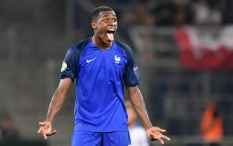epa05439589 French player Issa Diop celebrates scoring the 4-0 during the final of the UEFA U19 European Championship between France and Italy in Sinsheim, Germany, 24 July 2016.  EPA/Uwe Anspach