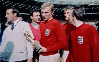 30th July 1966:  England captain Bobby Moore (1941 - 1993) with the Jules Rimet trophy, following England's 4-2 victory after extra time over West Germany in the World Cup Final at Wembley Stadium. Moore was subsequently voted 'Player Of The World Cup'.  (Photo by Hulton Archive/Getty Images)