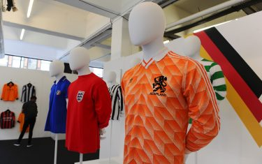 "(L-R) A football shirt from Italy, from the 80s, an England away shirt from 1966 and a Netherlands shirt from 1988 form part of ""The Art of the Football Shirt"" exhibition in east London on July 26, 2017. / AFP PHOTO / Robin MILLARD        (Photo credit should read ROBIN MILLARD/AFP via Getty Images)"