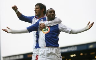 BLACKBURN, UNITED KINGDOM - FEBRUARY 24:  Benni McCarthy of Blackburn Rovers celebrates with team mate Roque Santa Cruz (L) after scoring his team's second goal from the penalty spot during the Barclays Premier League match between Blackburn Rovers and Bolton Wanderers at Ewood Park on February 24, 2008 in Blackburn, England.  (Photo by Clive Brunskill/Getty Images)