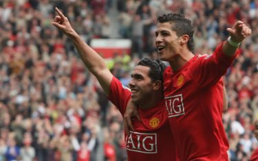 MANCHESTER, ENGLAND - OCTOBER 6:  Carlos Tevez of Manchester United celebrates scoring their first goal during the Barclays FA Premier League match between Manchester United and Wigan Athletic at Old Trafford on October 6 2007 in Manchester, England. (Photo by Chris Coleman/Manchester United via Getty Images)