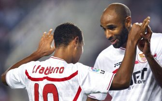 epa02410688 Sevilla's Brazilian striker Luis Fabiano (L) celebrates with his team-mate French striker Frederic Kanoute after scoring their team's third goal during the Spanish Primera Division match between Sevilla and Athletic Bilbao at Ramon Sanchez Pizjuan stadium in Seville, Spain, 24 October 2010.  EPA/EDUARDO ABAD