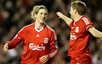 Liverpool's Fernando Torres (left) celebrates scoring his sides second goal with teammate Steven Gerrard (right)