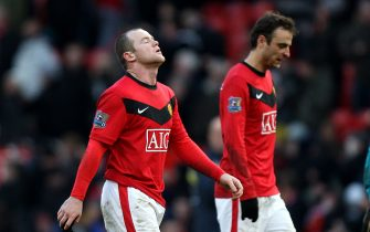 Manchester United's Wayne Rooney (left) and Dimitar Berbatov walk off dejected after the final whistle
