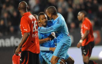 FOOTBALL - FRENCH CHAMPIONSHIP 2010/2011 - L1 - STADE RENNAIS v OLYMPIQUE MARSEILLE  - 11/03/2011 - PHOTO PASCAL ALLEE / DPPI -  JOY JORDAN AYEW AND LOIC REMY (OM) AFTER THE GOAL OF LUCHO