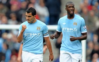 epa02356499 Manchester City's Carlos Tevez (L) celebrates with his team mate Yaya Toure (R) after scoring the winning goal during the English Premier League soccer match between Manchester City and Chelsea FC at the City of Manchester Stadium in Eastlands, Manchester, Britain, 25 September 2010. Manchester City won 1-0.  EPA/FOTOSPORTS - ROBIN PARKER NO ONLINE OR INTERNET USE WITHOUT A LICENSE FROM THE FOOTBALL DATA CO. LTD.