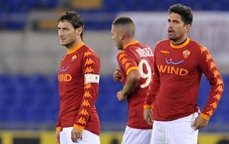 Borriello Menez e Totti dopo il 2-0 durante la partita di campionato di Serie A TIM Roma - Udinese, questa sera 20 novembre 2010 allo Stadio Olimpico di Roma.         ANSA / MAURIZIO BRAMBATTI