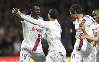 FOOTBALL - FRENCH CHAMPIONSHIP 2010/2011 - L1 - OLYMPIQUE LYONNAIS v STADE RENNAIS - 19/03/2011 - PHOTO JEAN MARIE HERVIO / DPPI - JOY BAFETIMBI GOMIS (OL) WITH LISANDRO LOPEZ AFTER HIS GOAL