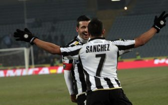 Chilean forward of Udinese, Alexis Sanchez, jubilates with his teammate Antonio Di Natale after scoring the goal against Sampdoria during their Italian Serie A soccer match at Friuli stadium in Udine, Italy on 05 February 2011.