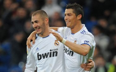 MADRID, SPAIN - DECEMBER 22:  Cristiano Ronaldo (R) of Real Madrid celebrates with Karim Benzema after scoring his second goal against Levante in the first leg round of 16 Copa del Rey match between Real Madrid and Levante at Estadio Santiago Bernabeu on December 22, 2010 in Madrid, Spain.  (Photo by Denis Doyle/Getty Images)
