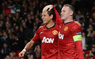 epa03444172 Manchester United's Javier Hernandez (L) celebrates scoring with team mate Wayne Rooney (R) during the UEFA Champions League group H between Manchester United and Sporting Braga at Old Trafford, Manchester, Britain, 23 October 2012.  EPA/PETER POWELL