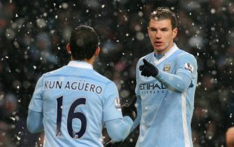 epa03092150 Manchester City's Edin Dzeko (facing) celebrates scoring their third goal against Fulham with team mate and first goal scorer Sergio Aguero during their English Premiership league soccer match against Fulham at the Etihad stadium in Manchester, north west England 04 February 2012. DataCo terms and conditions apply http//www.epa.eu/downloads/DataCo-TCs.pdf  EPA/LINDSEY PARNABY
