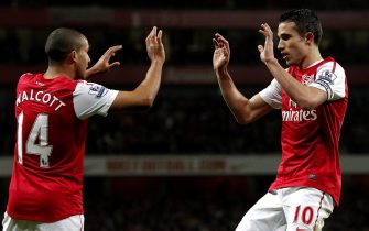 epa03142458 Arsenal's Robin van Persie (R) and Theo Walcott (L) celebrates after scoring against Newcastle United during the English Premier League soccer match, Arsenal vs Newcastle United, at the Emirates stadium, London, Britain, 12 March 2012.  EPA/KERIM OKTEN DataCo terms and conditions apply. http//www.epa.eu/downloads/DataCo-TCs.pdf