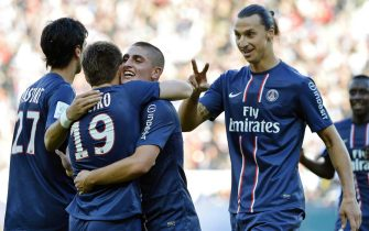 epa03415018 Kevin Gameiro (L) of PSG celebrates with his his teammates Zlatan Ibrahimovic (R) and Marco Verratti (C) after scoring the 2-0 lead during the French Ligue 1 soccer match between Paris Saint Germain and FC Sochaux Montbeliard at Parc des Princes in Paris, France, 29 September 2012.  EPA/STEPHANE REIX