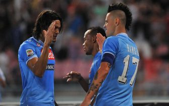 Slovak midfielder of Ssc Napoli, Marek Hamsik (R), celebrates with his teammate Cavani after scoring the 1-0 against Udinese during Italian Serie A soccer match at San Paolo stadium in Milan, 7 October 2012. ANSA/CESARE ABBATE