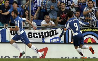 RCD Espanyol'S Ricardo Stuani (L) celebrates his goal against Real Madrid during their Spanish Primera Division League soccer match played at the Power8 stadium in Barcelona, northeastern Spain, 17 May 2015. EFE/Alberto Estevez