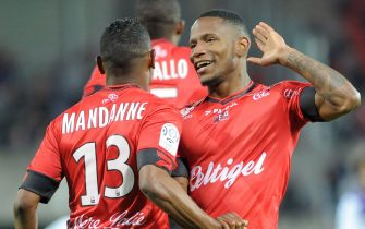 Guingamp's French midfielder Claudio Beauvue (R) celebrates with teammate Christophe Mandanne (L) after scoring during the French L1 football match Guingamp v Toulouse on May 16, 2015 at the Roudourou stadium in Guingamp, western of France.  AFP PHOTO FRED TANNEAU        (Photo credit should read FRED TANNEAU/AFP via Getty Images)