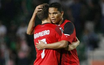 epa04454051 Sevilla FC's Colombian striker Carlos Bacca (R) and French player Gameiro (L) celebrate after scoring against Elche during the Spanish Primera Division soccer match, Elche vs Sevilla FC, at Martinez Valero stadium, in Elche, eastern Spain, 19 October 2014.  EPA/MANUEL LORENZO